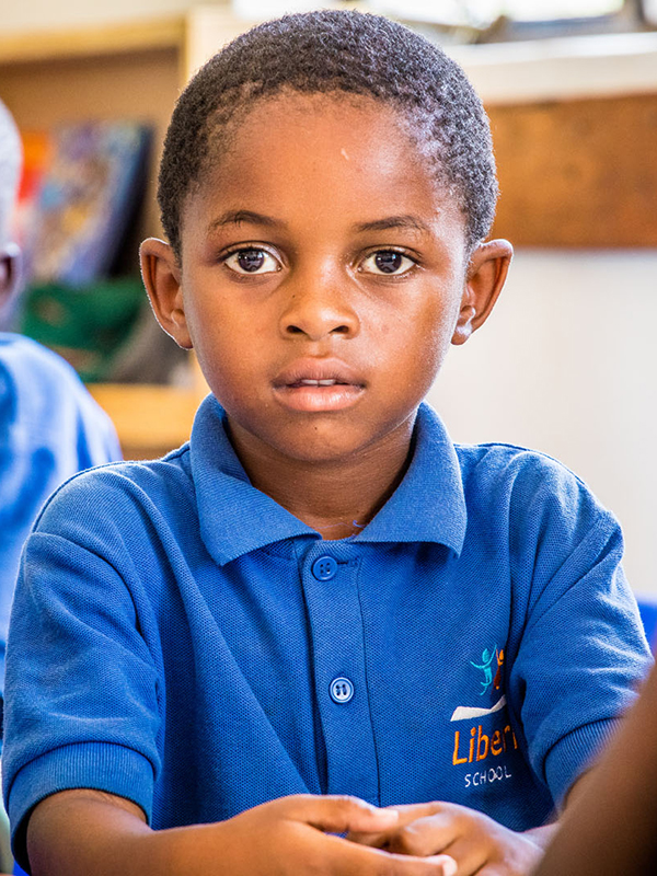 A pupil at the Liberi School which is situated by Aller Aqua Zambia